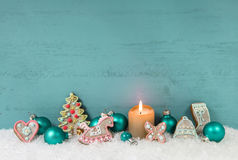 Shabby chic christmas background with candle and gingerbread. Royalty Free Stock Photography