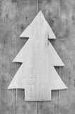 Shabby chic christmas decoration. Handmade carved tree on wooden Royalty Free Stock Photos