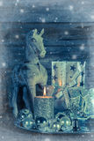Shabby chic christmas decoration in silver with wooden horse, ca Royalty Free Stock Photos