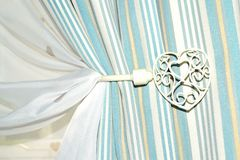 Shabby chic curtain holder. Beautiful shabby chic curtain holder detail Royalty Free Stock Photography