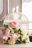 Shabby chic decoration with beautiful vintage birdcage and flowers.  Royalty Free Stock Photos