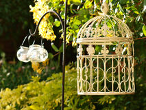 Shabby Chic Garden. Shabby Chic lanterns in Summer Garden at twilight royalty free stock images