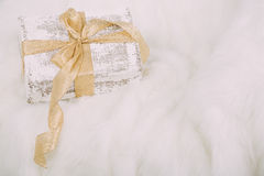 Shabby chic gift with golden ribbon on white  background Royalty Free Stock Image