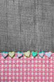 Shabby chic grey wooden background with hearts on a pink white c Stock Photo