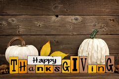 Shabby chic Happy Thanksgiving wood sign with pumpkin decor against wood Stock Photography