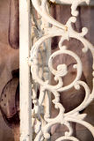 Shabby Chic Iron Work. Vintage iron railing with rust and intricate scrolled design Stock Images