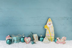 Shabby chic mint green or turquoise wooden background with santa Royalty Free Stock Images