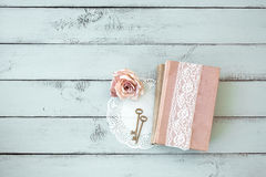 Shabby chic. Old books with lace, rose and keys on shabby chic mint background, top view point royalty free stock photos