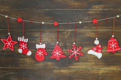 Shabby chic rustic Christmas decoration. S on brown wooden board Stock Image