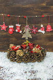 Shabby chic rustic Christmas decoration. S on brown wooden board and snow Stock Images