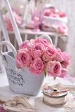 Shabby chic style decoration with pink roses Stock Photo
