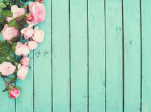 Shabby Chic Vintage Wooden Background with Roses.