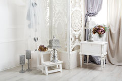 Shabby chic white room interior, wedding decor. Shabby chic room interior. Wedding decor, room decorated for shabby chic rustic wedding, with bedside table stock photos