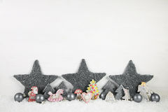 Shabby chic wooden christmas background in white and grey. Royalty Free Stock Images