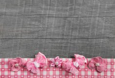 Shabby chic wooden grey background with pink ribbon on white che Royalty Free Stock Images