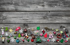 Shabby chic wooden grey christmas background with colored miniat Royalty Free Stock Photos