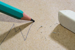Shabby craft paper background with pencil and eraser, draw a line growth Royalty Free Stock Photography
