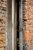 Shabby door and brick wall Stock Image
