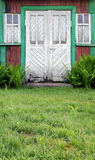 Shabby doors of poor living house Royalty Free Stock Photos
