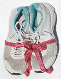 Shabby elder training shoes with measuring tape Stock Photography