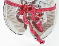 Shabby elder training shoes with measuring tape Stock Images
