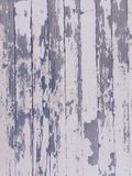 Shabby grungy peeling paint on wood texture Stock Photos