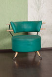 Shabby leather armchair in the interior Royalty Free Stock Photos