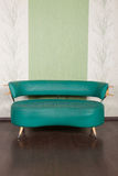 Shabby leather divan  in the interior. Green shabby leather divan in the interior Royalty Free Stock Image