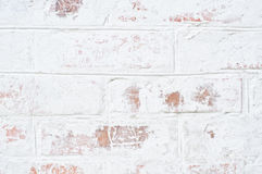 Shabby old brick wall. White old brick wall with breakaway plaster Stock Photos