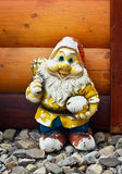 Shabby old figure of a garden gnome Stock Photography