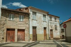 Shabby old houses with wooden doors on empty alley. Shabby old houses with wooden doors on empty cobblestone alley and NO ENTRY signpost, in a sunny day at royalty free stock photo