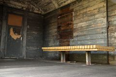 Shabby old wooden wagon from the inside, with bench.  Stock Images