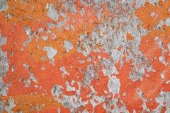 Shabby orange paint from concrete walls. Orange-gray texture royalty free stock image