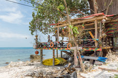 Shabby seaside shack on poles. Hippie shack at the shore on tropical island Koh Pangan. Esco Bar at sunset beach Haad Rin. May 03, 2016 Stock Image