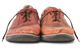 Shabby Shoes. Pair of very worn old leather dress shoes isolated on white Stock Photo