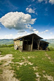 Shabby stables on the hills Stock Photo