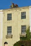 Shabby town house on coast Stock Photo