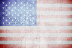 Shabby USA flag on a white wall Stock Photo