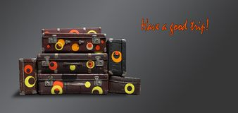 Shabby Vintage Ancient Suitcases.  Concept travel on a dark back Royalty Free Stock Photos