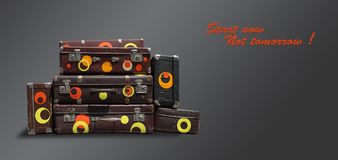 Shabby Vintage Ancient Suitcases. Concept travel with the inscr stock photography