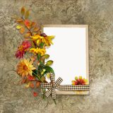 Shabby vintage background with flowers and a retro card with space for text or photo Stock Image