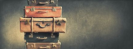 Shabby Vintage Stacked Ancient Suitcases. Travel Concept Brown Luggage Background Banner Royalty Free Stock Photo