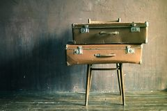 Shabby Vintage Stacked Ancient Suitcases Travel royalty free stock photos
