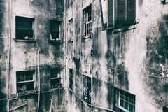 Shabby walls and windows of a residential building. Stock Photo