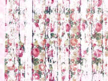 Shabby wood-grain texture white washed with distressed roses pattern. Shabby distressed wood-grain peeling paint texture white washed with floral rose pattern stock photo