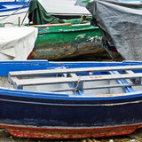 Shabby Wooden Boats. Wooden Boats on the Mediterranean Coast in the Italian City of Cetara Stock Photo