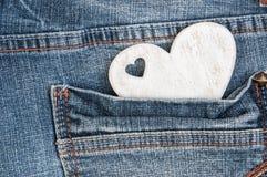 Shabby wooden heart in pocket Royalty Free Stock Photography