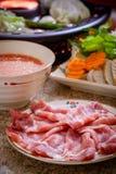 Shabu shabu. Asian cuisine on table stock photos