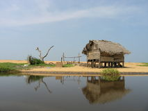 Shanty on the bank of the river Royalty Free Stock Image