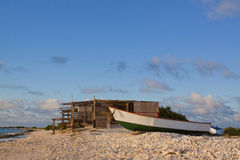 Shack on Beach with Boat Royalty Free Stock Images